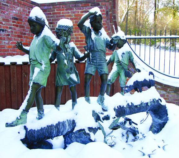 Bronze statue in snow