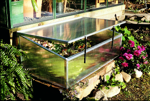 a picture of a cold frame for keeping plants warm in cold weather