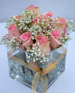 a picture of a rose and baby's breath flower arrangement