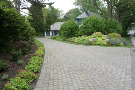 A picture of an attractive paver-stone driveway