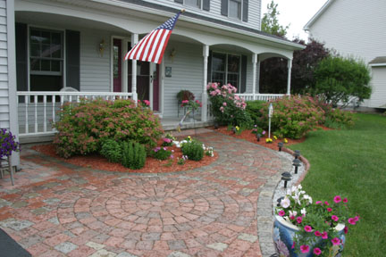 a photo of a landscaped entrance to a home