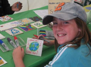 An image of a child tile painting at the Green Homes Festival