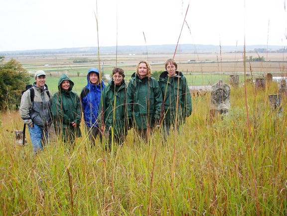 A photo of Cindy Gilberg a the SNR group collecting native seeds in NW Arkansas.