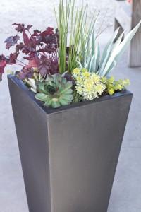 A picture of a contemporary plastic resin garden planter.