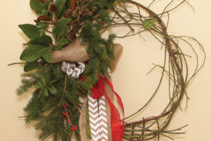 A photo of a holiday vine wreath made from wintercreeper vine.