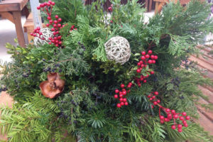 An image of a porch pot decorated with holiday greens